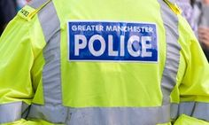 Greater Manchester police sorry for photo of men in Nazi uniforms | UK news | The Guardian