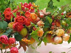 compote flower arrangement with orange flowers - Ariella Chezar Design