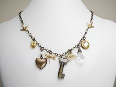 Antiqued charm necklace genuine pearl crystal by steampunknation, $38.00