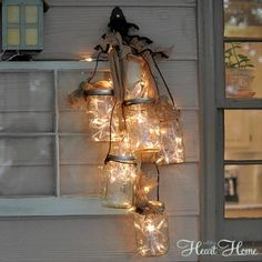 Hanging Jar Lantern Add glowing charm to your door by turning an armful of jars into a hanging lantern. (Robin @All Things Heart and Home)