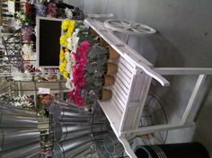 A flower cart display in the San Diego store
