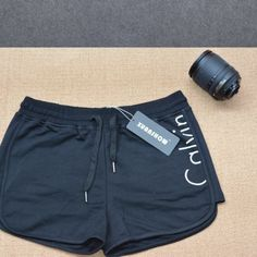 Calvin Klein Tops - Classic black cropped sweatshirt and shorts