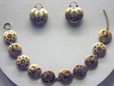 """""""Earrings and necklace. Gold, enamel. 1st half 12th c. Hoard found 1840s near Church of the Tithe, Kiev.""""  State Historical Museum, Moscow :: Early Rus Period"""