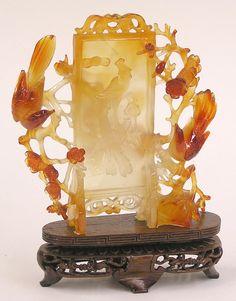 A carnelian carving of a Phoenix & prunus sprays