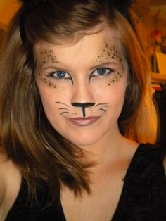 Super easy leopard makeup look for Halloween. Use black paint for the nose. Use gold eyeshadow around the eyes and then take a fine-line black liquid liner and make little 'c's and circles inside the gold shadow. In case I ever dress up as a Leopard :) Cheetah Face Paint, Cheetah Makeup, Lion Makeup, Kitty Face Paint, Lion Face Paint Easy, Cool Halloween Costumes, Halloween Kids, Halloween Face Makeup, Halloween 2019