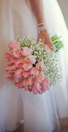 tulips and babies breath -- would make a stunning table bouquet as well