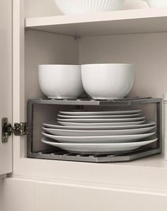 A tiered corner shelving unit adds even more usable space for your dishware.