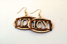 Joy earring Natural Wood.  One of our many designs available to www.etsy.com/shop/realwoodjewelry.  Made from solid hardwood.