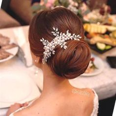 Sleek classic updo with pearl headpiece. Gorgeous wedding hairstyles, bridal beauty