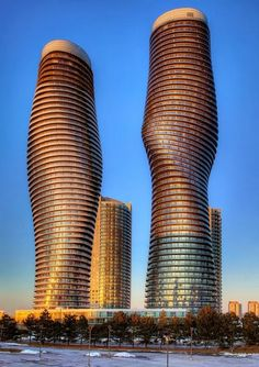 Ontario, Canada - Absolute World Towers in Mississauga (nicknamed the Marilyn Monroe Buildings for their curvy shapes) is a residential condominium twin tower skyscraper complex. Unusual Buildings, Amazing Buildings, Modern Buildings, City Buildings, Futuristic Architecture, Beautiful Architecture, Art And Architecture, Ottawa, Canada