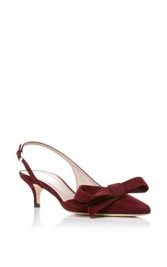 Aerin Pointed Toe Sling Back Pump With Bow is rendered in suede and features a bow on the toe and kitten heel.