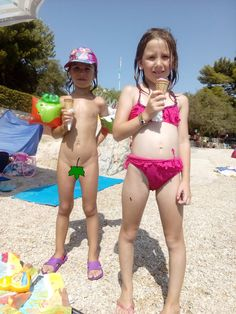 Two young European girls enjoy ice creams on a sunny afternoon in the seaside resort of Umag in Northern Croatia. This area is always very popular in season with families from across Europe, due to the affordable hotels and package deals.