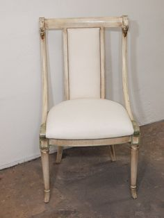 1stdibs.com - six Gianni Versace painted chairs with swan's head detail - these would be a DREAM - but they're $1620 a chair!!