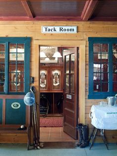 Windows from tack room into barn can open up a typically tightly closed up space and show off your stylish tack room!