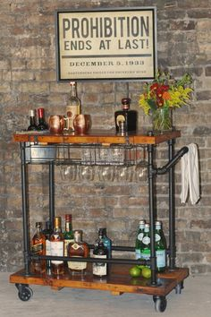 One of a kind, handmade industrial bar/utility cart. Perfect for entertaining. Made from reclaimed barn wood and steel pipe. The attention to detail will wow your most discerning guests. The cart holds up to 6 bottles of liquor in the top speed rail , 6 wine glasses in the undercarriage, a galvanized tub for ice as well as a conveniently located bottle opener. Additional bottles and/or glasses can be stored on the bottom shelf.  **Due to the fact we use reclaimed wood and vintage accents…