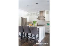 """A classic white U-shaped kitchen and large island was thoughtfully designed with functionality top of mind. Beautiful and subtle quartz countertops from The Old Barn and simple white subway tile complete the timeless aesthetic.    See more of this home in """"Childhood Dream Becomes Reality on Saugeen River"""" from OUR HOMES Grey & Bruce Spring 2017:  http://www.ourhomes.ca/articles/build/article/childhood-dream-becomes-reality-on-saugeen-river"""