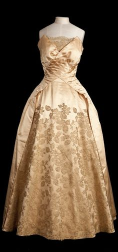 Evening gown, silk satin with appliqué lace work, Norman Hartnell (probably), early 1950s. Worn by Queen Elizabeth II. Historic Royal Palaces © Her Majesty Queen Elizabeth II 2013.