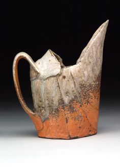 Bede Clarke's Pitcher, 7 in. (18 cm) in height,  wheel-thrown and altered stoneware, Rhodes Crackle Slip, Malcolm Davis Red Shino glaze, fired in a wood kiln, 2010. Clarke's work is discussed by Glen R. Brown in the September 2014 issue of Ceramics Monthly.  Want the Rhodes Crackle Slip recipe? See page 68 of the issue.  Want the Malcolm Davis Shino recipe? Visit www.ceramics monthly.org. See the table of contents: http://ceramicartsdaily.org/ceramics-monthly/ceramics-monthly-september-2014/