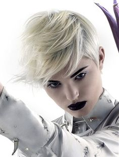 A short blonde straight coloured platinum white hairstyle by Neil Barton