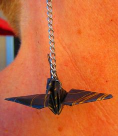 Handcrafted origami crane earrings black and gold. $15.00, via Etsy.