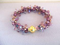 Purple Crystal Teardrop and Dagger Beaded Kumihimo Bracelet by LotsofKnotsCreations on Etsy https://www.etsy.com/listing/210131614/purple-crystal-teardrop-and-dagger