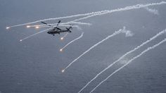 "PHILIPPINE SEA (April 24, 2017) An MH-60R Sea Hawk helicopter from the ""Blue Hawks"" of Helicopter Maritime Strike Squadron (HSM) 78 fires chaff flares during a training exercise near the aircraft carrier USS Carl Vinson (CVN 70). U.S. Navy aircraft carrier strike groups have patrolled the Indo-Asia Pacific routinely for more than 70 years. (U.S. Navy photo by Mass Communication Specialist 2nd Class Sean M. Castellano/Released)"