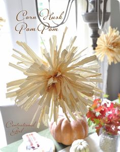 Add some whimsy to your Thanksgiving tablescape with these gorgeous Corn Husk Pm Poms from centsationalgirl.com