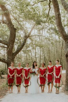 These off-the-shoulder red lace bridesmaids dresses are the epitome of glamorous wedding style | Image by Dearheart Photos