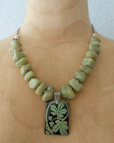 Olive Green Afghan Stone, Sterling Silver, Lilly Pilly Etched Shell Pendant Necklace via Etsy.
