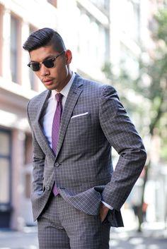 Charcoal plaid suit + purple dot tie + pocket square