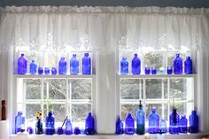 I have cobalt blue glass like this....my dream has always been to display it in a window in the light.