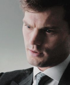 Christian in a business meeting, but his thoughts keep straying to Ana.