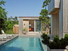 A new guesthouse and swimming pool are among the updates to a 56-year-old home on Fire Island that has been overhauled by American studio Andrew Franz Architect.