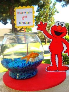 Dorothy the fish makes a lively addition to an Elmo birthday party.  See more Elmo birthday party ideas at www.one-stop-party-ideas.com