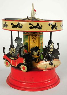 One of only a few known examples of Gunthermann (Germany) Felix Carousel tinplate wind-up toy.