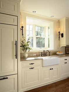 gorgeous!! cab color, dark handles and pulls, farm sink, disguised fridge, counter, faucet...everything