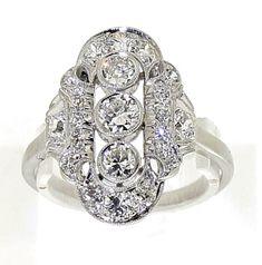 Witgouden Art Déco prinsessen ring bezet met diamanten, totaal een geschat gewicht van 1.30ct, met in het midden drie grotere briljant geslepen diamanten, de middensteen is ca. 0.20 ct, de steen onder en boven zijn 0.15ct. - SpiegelgrachtJuweliers.com   ringen   zilveren ring   silver rings jewelry   vintage rings   trouw ringen zilver   verlovingsring zilver   sieraden amsterdam #spiegelgrachtjuweliers #ring #rings Vintage Art Deco Rings, Vintage Silver Rings, Vintage Diamond, Vintage Jewelry, Gold Diamond Rings, Gold Rings, Silver Engagement Rings, White Gold, Entourage