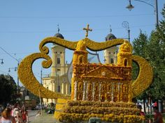Characters Made of Flowers at Debrecen's Carnival, Hungary The great churches replica out of dried flowers