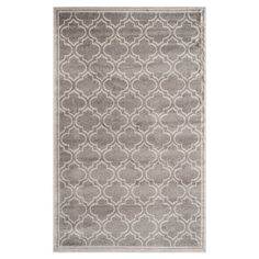 Featuring a quatrefoil trellis motif in ivory and olive gray, this artfully crafted rug adds a pop of pattern to your living room or master suite.