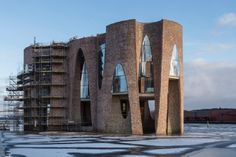 Kirk Kapital's new domicile in Vejle will be inaugurated on 9 June. Fjordenhus will be the name of the building that Studio Olafur Eliasson designed. Studio Olafur Eliasson, Vejle, Work Inspiration, Brooklyn Bridge, Denmark, This Is Us, Architecture Design, Brick, Building