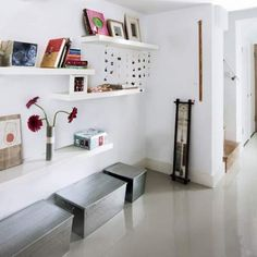 Floating shelves on a wide open space eliminate use of large cupboard while becoming a feature themselves