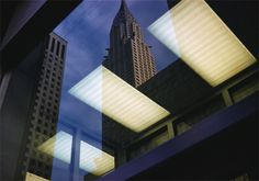 This image looks like its been taken from a window as you can see the reflection of lights but it works really well with the buildings in the image, also the angle that this is taken shows different shapes of the buildings. Another image by Ernst Haas