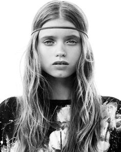 Boho style: nose ring, across the forehead headband, and gentle waves.