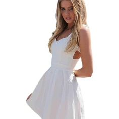White spring/ summer dress- NEW Super cute spring dress! Great for photos, a day with friends or date night! Never worn and new with tags! Condition Great! Fits a medium or large! Dresses