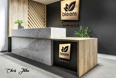 Free mockup by Creative Alys which provides a highly realistic scene with a professional-looking reception desk with wooden and marble designs.