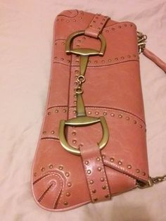 A beautiful blush studded handbag or clutch that resembles a Gucci horse bit bag.Great condition inside and out. …