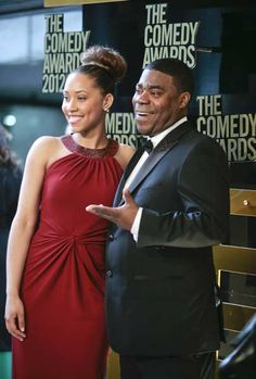 Model Megan Wollover (L) and actor Tracy Morgan arrive at the Comedy Awards 2012 in New York City, New York April 28, 2012.