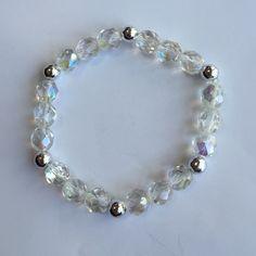 Beautiful handmade jewelry! Iridescent clear and silver beaded slip on bracelet. Jewelry Bracelets