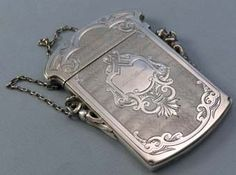 """N9954 Gorham Sterling Card Case    A Gorham sterling card case with two cast figural supports holding links that carry the chain. The surfaces are engine turned and engraved. Engraved """"Ellen A Sherrill"""". Length 4"""" by 2 1/2""""T    Price: $395.00"""