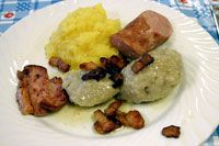 "Typical Norwegian: ""komle"". Potato dumplings with mashed rutabaga, extra large hot dogs, salted pork and bacon."